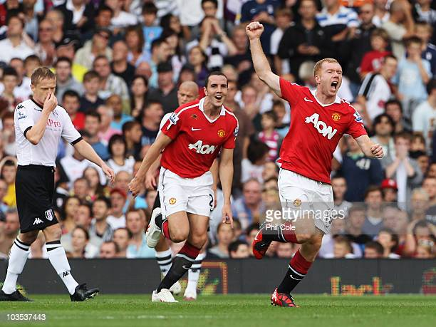 Damien Duff of Fulham looks dejected as Paul Scholes of Manchester United celebrates with John O'Shea as he scores their first goal during the...