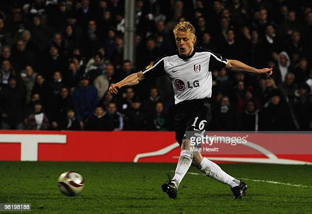 Damien Duff of Fulham scores their second goal during the UEFA Europa League quarter final first leg match between Fulham and Vfl Wolfsburg at Craven...