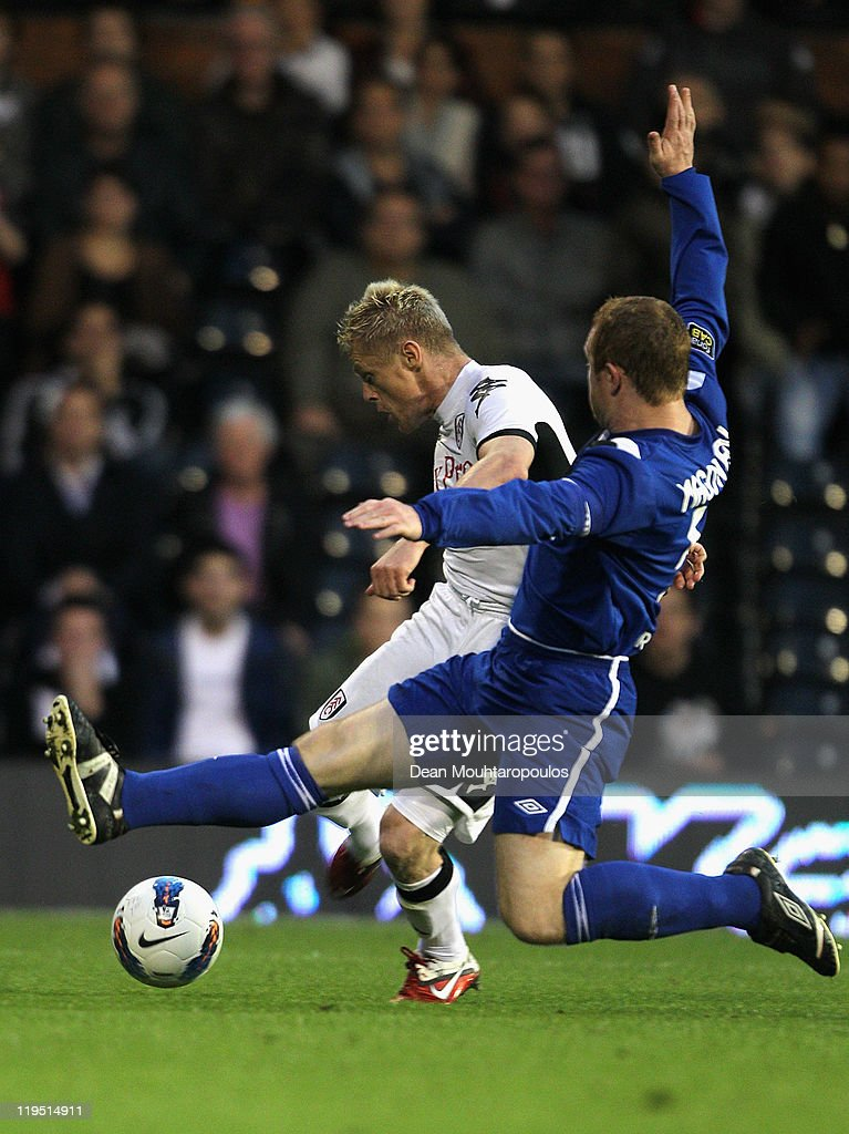 <a gi-track='captionPersonalityLinkClicked' href=/galleries/search?phrase=Damien+Duff&family=editorial&specificpeople=171295 ng-click='$event.stopPropagation()'>Damien Duff</a> of Fulham shoots and scores his team's second goal during the UEFA Europa League 2nd Qualifying Round 2nd Leg match between Fulham and Crusaders at Craven Cottage on July 21, 2011 in London, England.