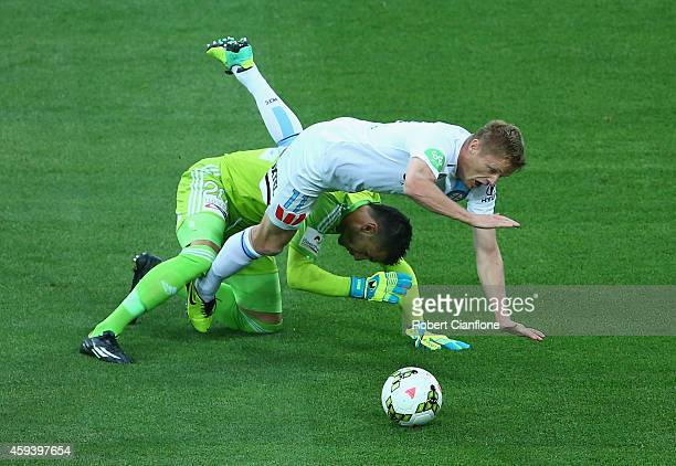 Damien Duff of Melbourne City is challenged by Sydney FC goalkeeper Vedran Janjetovic during the round seven ALeague match between Melbourne City and...