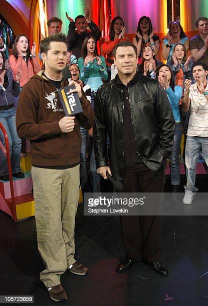 Damien Fahey and John Travolta during John Travolta and Rachel Bilson Visit MTV's 'TRL' February 23 2005 at MTV Studios in New York City NY United...