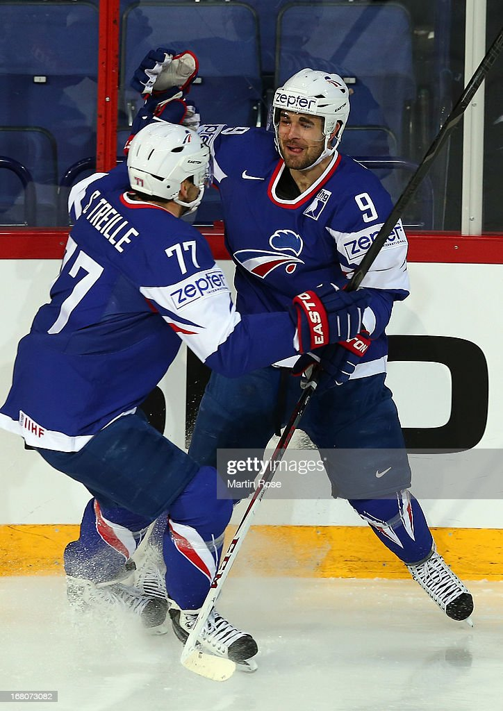 Damien Fleury (R) of France celebrate with team mate Sacha Treille after he scores his team's opening goal during the IIHF World Championship group H match between France and Austria at Hartwall Areena on May 5, 2013 in Helsinki, Finland.