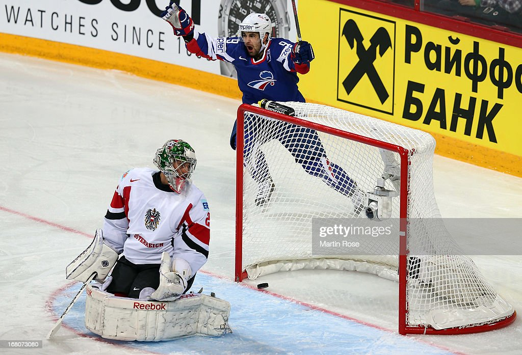 Damien Fleury (back) of France celebrates after he scores his team's opening goal during the IIHF World Championship group H match between France and Austria at Hartwall Areena on May 5, 2013 in Helsinki, Finland.
