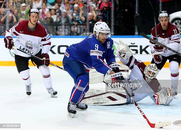 Damien Fleury of France fails to score over Edgars Masalskis goaltender of Latvia during the IIHF World Championship group A match between Latvia and...