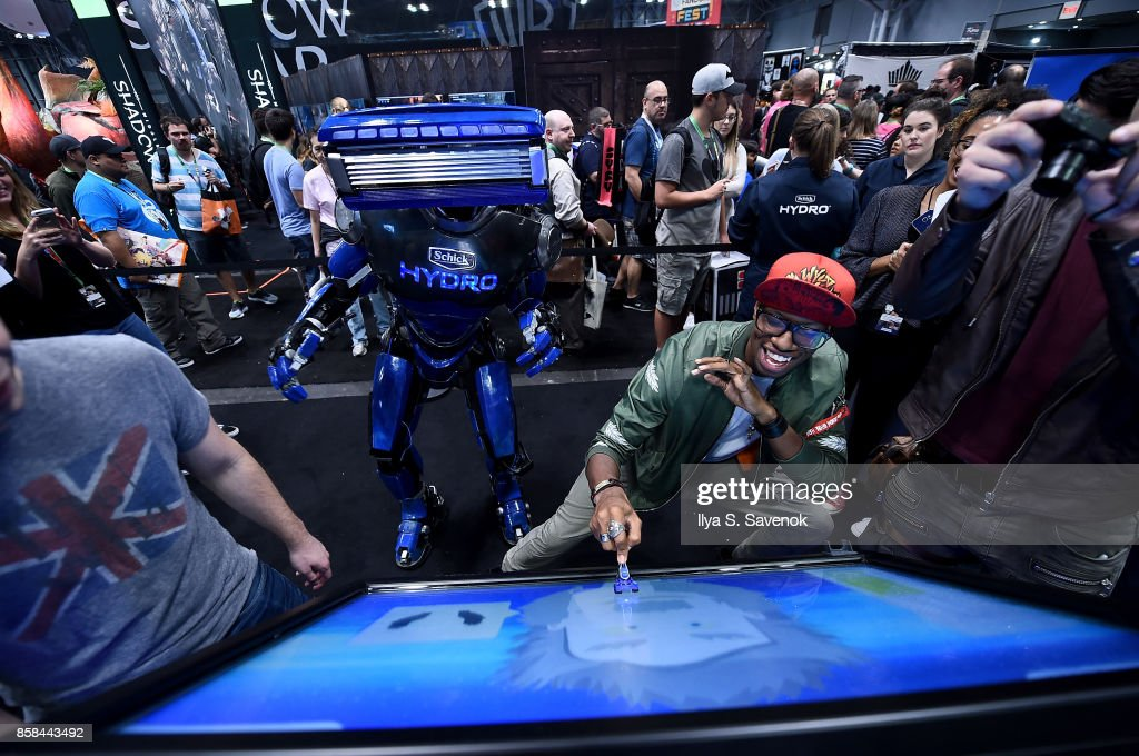 Damien Haas, Amra 'Flitz' Ricketts, and Wes Johnson of the Smosh Games crew play the 'Schick Shave Off' video game with Schick Hydro At New York Comic-Con 2017 on October 6, 2017 in New York City.