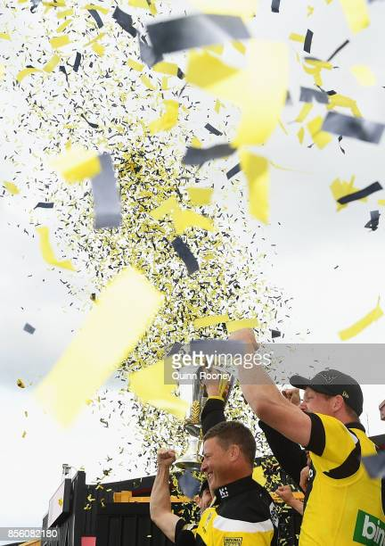 Damien Hardwick and Trent Cotchin of the Tigers show the Premiership Trophy to the crowd after winning yesterday's AFL Grand Final at Punt Road Oval...