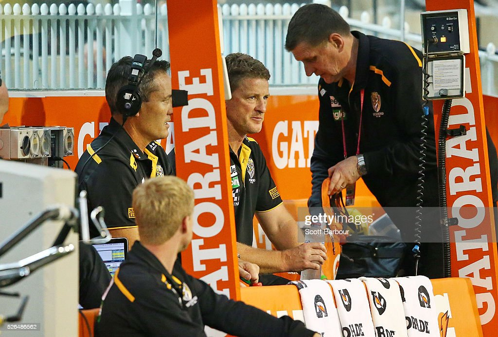 <a gi-track='captionPersonalityLinkClicked' href=/galleries/search?phrase=Damien+Hardwick&family=editorial&specificpeople=162730 ng-click='$event.stopPropagation()'>Damien Hardwick</a>, coach of the Tigers coaches from the boundary line during the round six AFL match between the Richmond Tigers and the Port Adelaide Power at Melbourne Cricket Ground on April 30, 2016 in Melbourne, Australia.