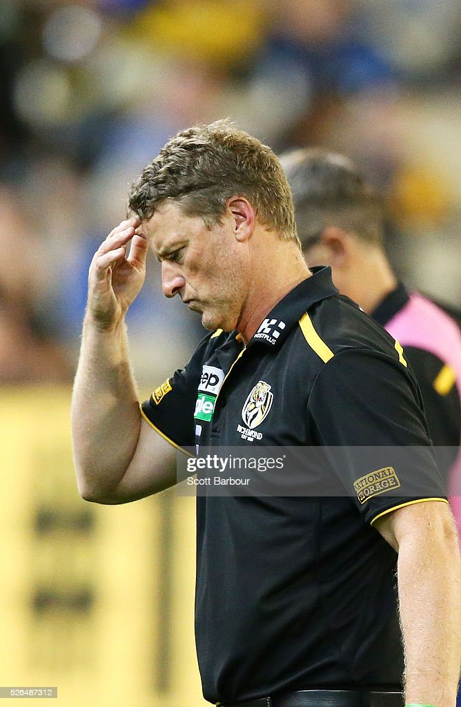 <a gi-track='captionPersonalityLinkClicked' href=/galleries/search?phrase=Damien+Hardwick&family=editorial&specificpeople=162730 ng-click='$event.stopPropagation()'>Damien Hardwick</a>, coach of the Tigers leaves the field after speaking to his team during the round six AFL match between the Richmond Tigers and the Port Adelaide Power at Melbourne Cricket Ground on April 30, 2016 in Melbourne, Australia.