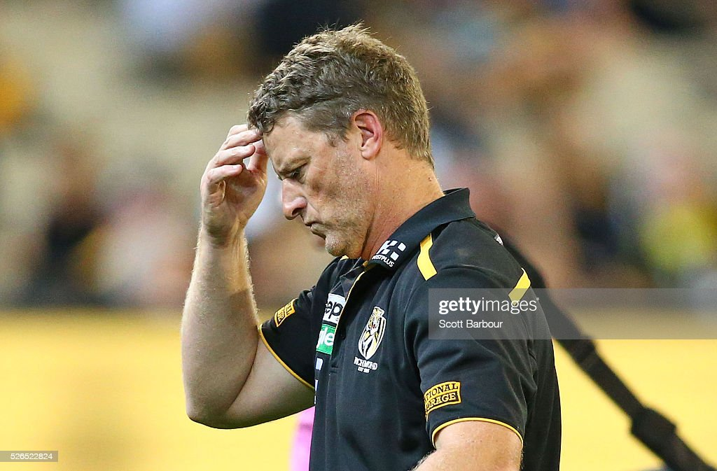 Damien Hardwick, coach of the Tigers leaves the field after speaking to his team during the round six AFL match between the Richmond Tigers and the Port Adelaide Power at Melbourne Cricket Ground on April 30, 2016 in Melbourne, Australia.