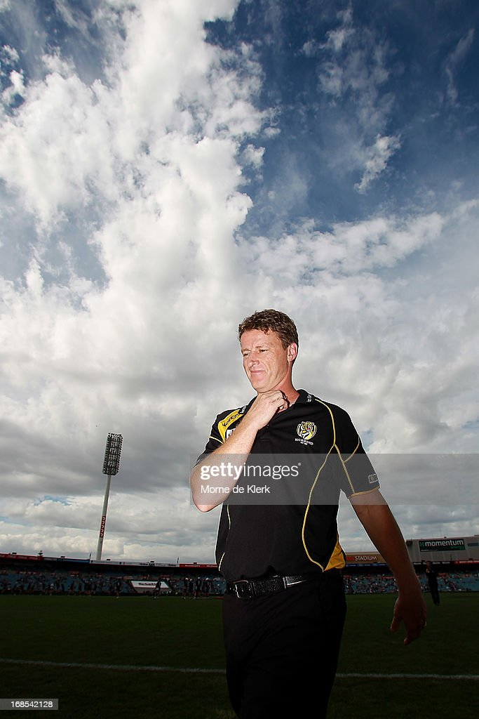 <a gi-track='captionPersonalityLinkClicked' href=/galleries/search?phrase=Damien+Hardwick&family=editorial&specificpeople=162730 ng-click='$event.stopPropagation()'>Damien Hardwick</a> of the Tigers looks on during the round seven AFL match between Port Adelaide Power and the Richmond Tigers at AAMI Stadium on May 11, 2013 in Adelaide, Australia.
