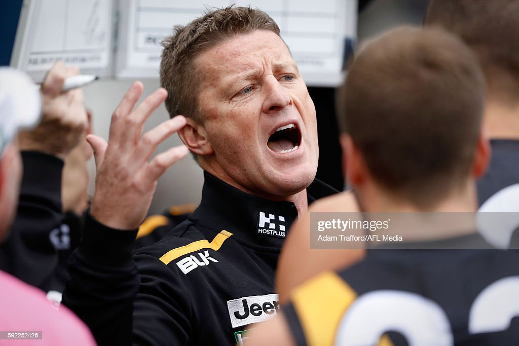 Damien Hardwick Senior Coach of the Tigers addresses his players during the 2016 AFL Round 22 match between the Richmond Tigers and the St Kilda...