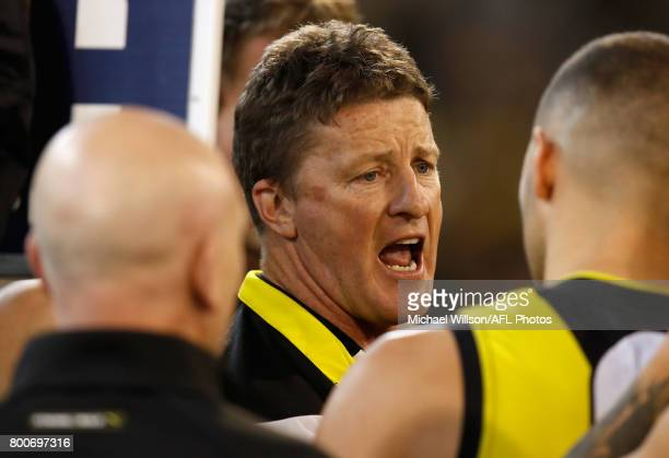 Damien Hardwick Senior Coach of the Tigers addresses his players during the 2017 AFL round 14 match between the Richmond Tigers and the Carlton Blues...