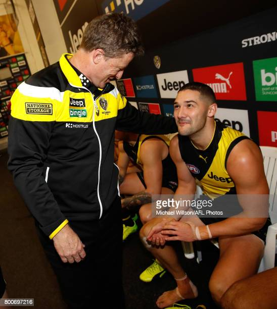 Damien Hardwick Senior Coach of the Tigers and Shaun Grigg of the Tigers celebrate during the 2017 AFL round 14 match between the Richmond Tigers and...