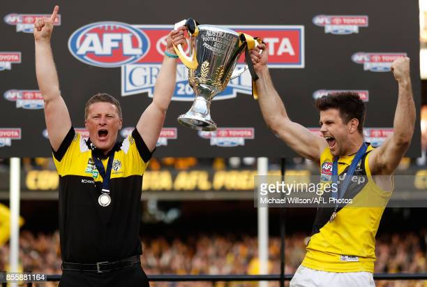 Damien Hardwick Senior Coach of the Tigers and Trent Cotchin of the Tigers hold the premiership cup aloft during the 2017 Toyota AFL Grand Final...