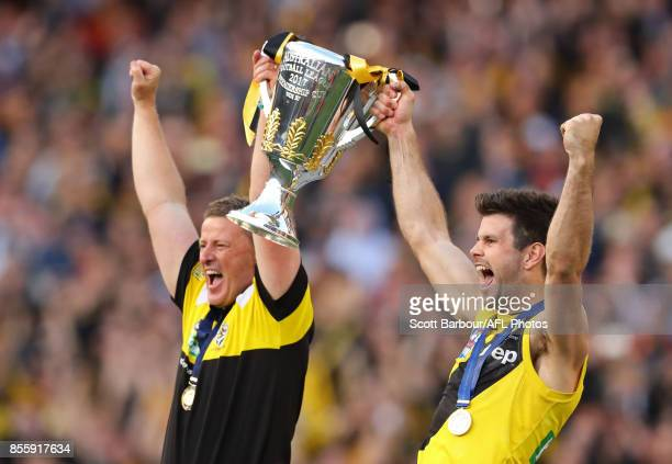 Damien Hardwick Senior Coach of the Tigers and Trent Cotchin of the Tigers hold the premiership cup aloft after winning the 2017 AFL Grand Final...