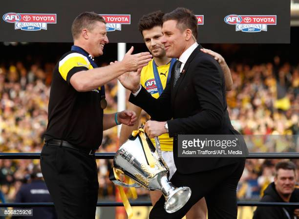 Damien Hardwick Senior Coach of the Tigers and Trent Cotchin of the Tigers receive the premiership cup from Matthew Richardson during the 2017 Toyota...