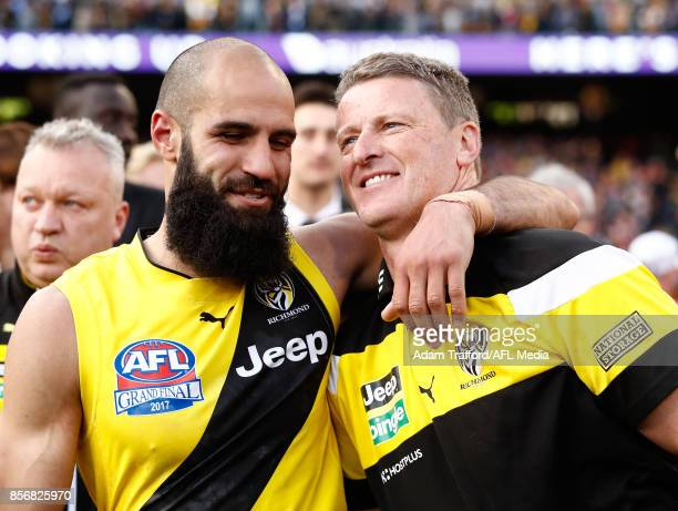 Damien Hardwick Senior Coach of the Tigers celebrates with Bachar Houli of the Tigers during the 2017 Toyota AFL Grand Final match between the...