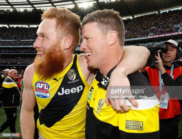 Damien Hardwick Senior Coach of the Tigers celebrates with Nick Vlastuin of the Tigers during the 2017 Toyota AFL Grand Final match between the...