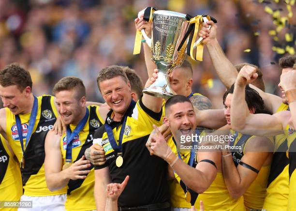 Damien Hardwick Senior Coach of the Tigers holds the premiership cup aloft after winning the 2017 AFL Grand Final match between the Adelaide Crows...