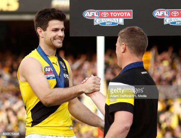 Damien Hardwick Senior Coach of the Tigers shakes hands with Trent Cotchin of the Tigers during the 2017 Toyota AFL Grand Final match between the...