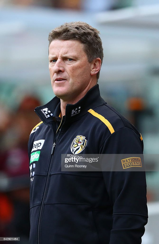 <a gi-track='captionPersonalityLinkClicked' href=/galleries/search?phrase=Damien+Hardwick&family=editorial&specificpeople=162730 ng-click='$event.stopPropagation()'>Damien Hardwick</a> the coach of the Tigers coaches from the boundary line during the round 14 AFL match between the Richmond Tigers and the Brisbane Lions at Melbourne Cricket Ground on June 25, 2016 in Melbourne, Australia.