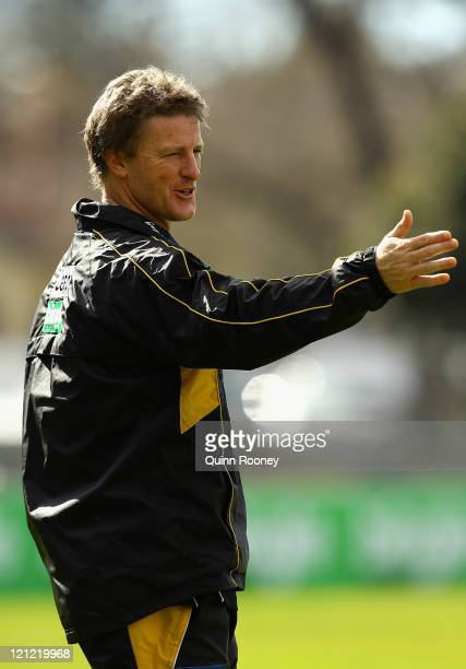 Damien Hardwick the coach of the Tigers gives instructions during a Richmond Tigers AFL training session at Punt Road Oval on August 16 2011 in...