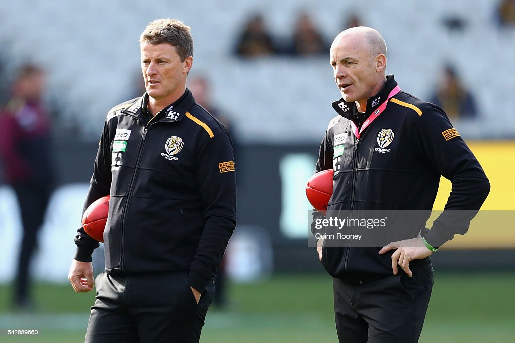 <a gi-track='captionPersonalityLinkClicked' href=/galleries/search?phrase=Damien+Hardwick&family=editorial&specificpeople=162730 ng-click='$event.stopPropagation()'>Damien Hardwick</a> the coach of the Tigers talsk to assistant coach Ross Smith during the round 14 AFL match between the Richmond Tigers and the Brisbane Lions at Melbourne Cricket Ground on June 25, 2016 in Melbourne, Australia.