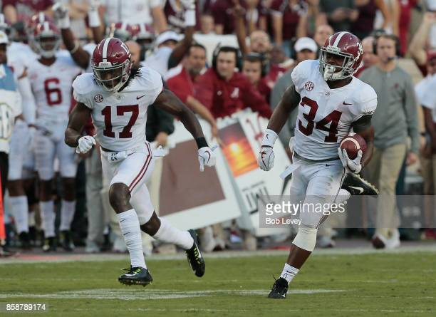 Damien Harris of the Alabama Crimson Tide runs for a 75 yard touchdown as Cam Sims attempts to get out in front for a block in the first quarter...