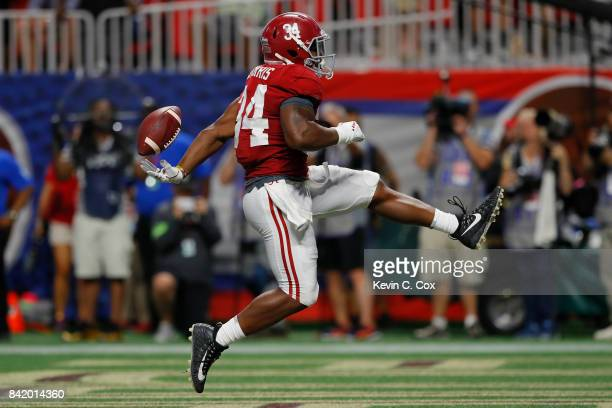 Damien Harris of the Alabama Crimson Tide rushes for a touchdown in the third quarter of their game at MercedesBenz Stadium on September 2 2017 in...