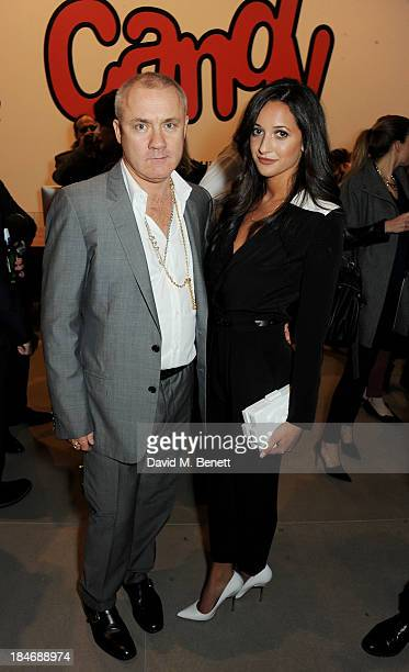Damien Hirst and Roxie Nafousi attend a private view of Damien Hirst And Felix GonzalezTorres's exhibition 'Candy' at Blain Southern on October 15...