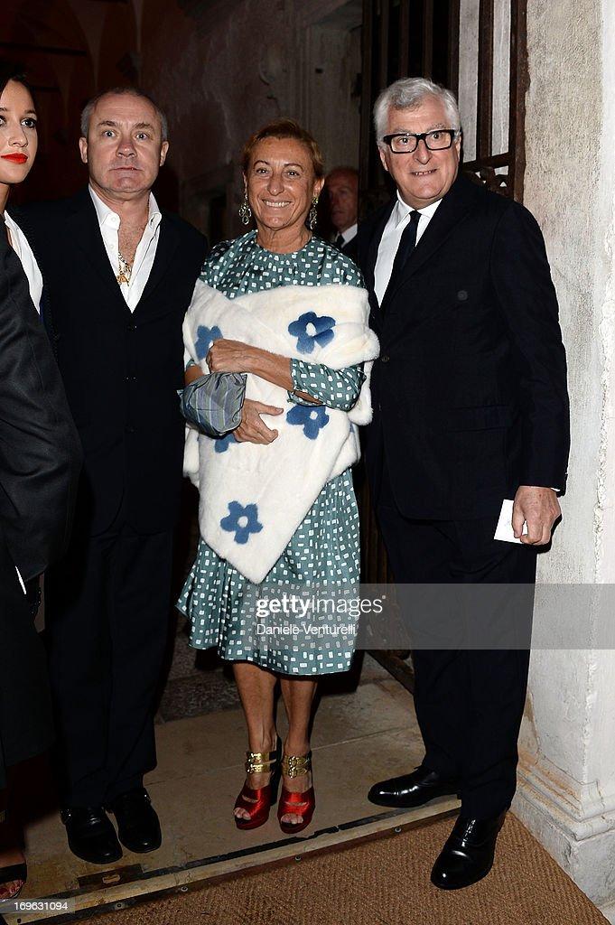 Damien Hirst, Miuccia Prada and Patrizio Bertelli attend the Dinner At 'Fondazione Cini, Isola Di San Giorgio' during the 2013 Venice Biennale on May 29, 2013 in Venice, Italy.
