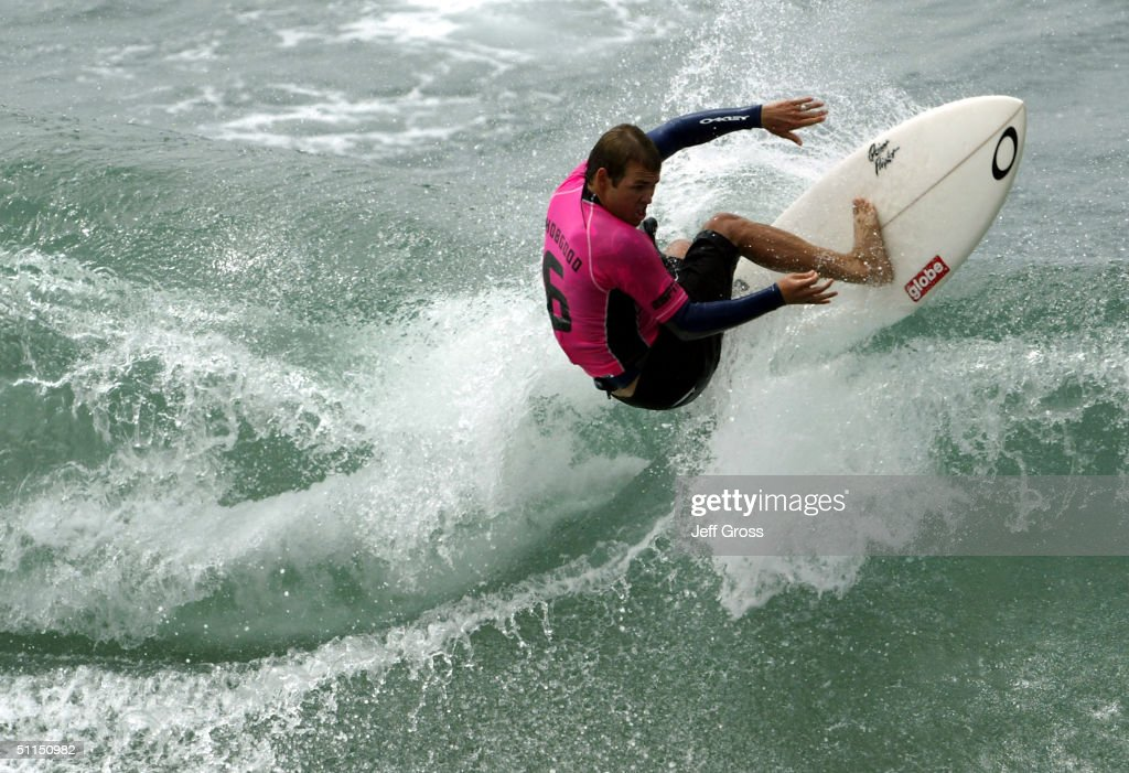 Damien Hobgood of team East Coast executes an off the top during the X Games surfing event on August 7 2004 at the Huntington Beach Pier in...