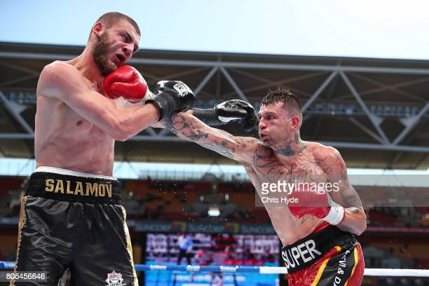 Damien Hooper of Australia and Umar Salamov of Russia exchange punches during their Light Heavyweight bout before the WBO Welterweight Title Fight...