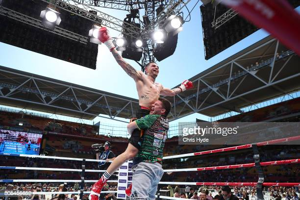 Damien Hooper of Australia celebrates winning against Umar Salamov of Russia after their Light Heavyweight bout before the WBO Welterweight Title...