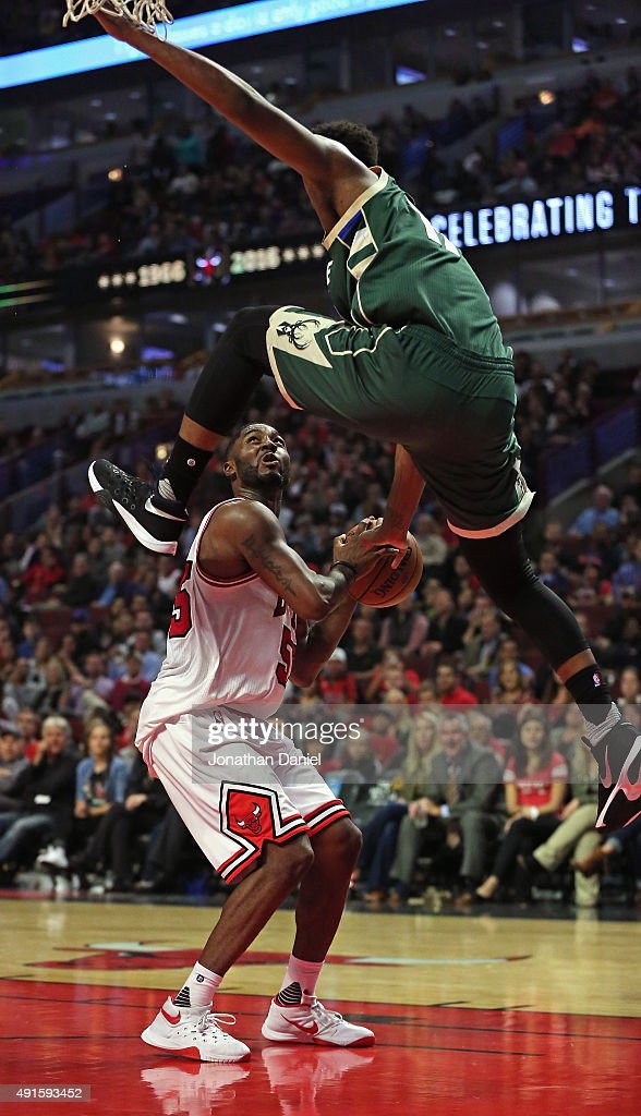 Damien Inglis #17 of the Milwaukee Bucks leaps over E'Twaun Moore #55 of the Chicago Bulls during a preseason game at the United Center on October 6, 2015 in Chicago, Illinois. The Bulls defeated the Bucks 105-95. Note to User: User expressly acknowledges and agrees that, by downloading and or using the photograph, User is consenting to the terms and conditiopns of the Getty Images License Agreement.