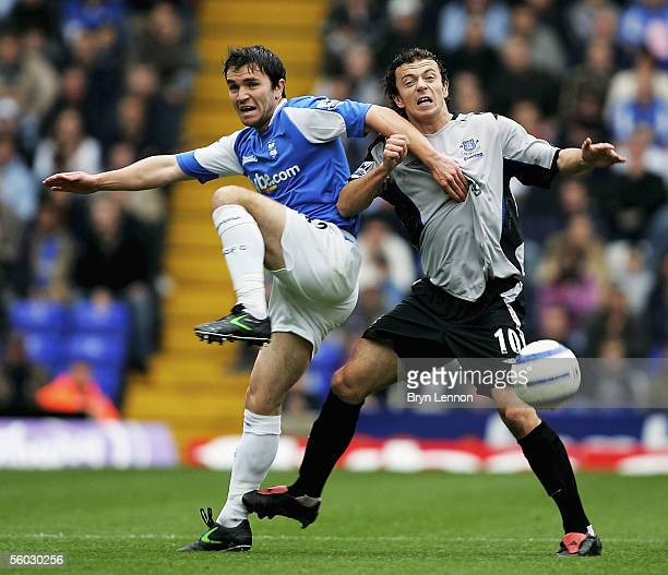 Damien Johnson of Birmingham CIty is tackled by Simon Davies of Everton during the Barclays Premiership match between Birmingham City and Everton at...