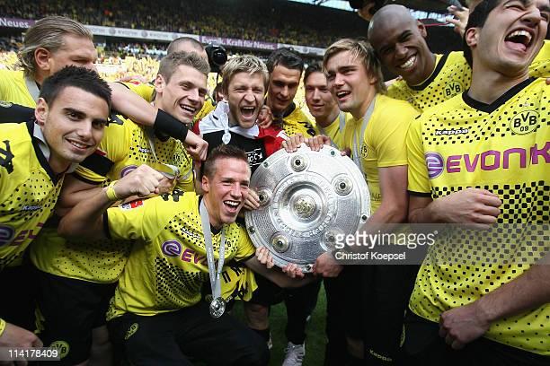 Damien le Tallec Lukasz Piszczek Kevin grosskreutz Marc Hornschuh Jakub Blaszczykowski Sebastian Kehl and Marcel Schmelzer of Dortmund lift the...