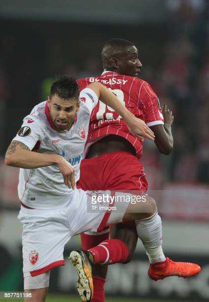 Damien Le Tallec of Belgrad and Sehrou Guirassy of Koeln battle for the ball during the UEFA Europa League group H match between 1 FC Koeln and...