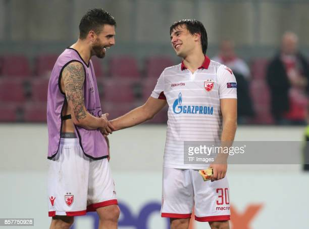 Damien Le Tallec of Belgrad shakes hands with Filip Stojkovic during the UEFA Europa League group H match between 1 FC Koeln and Crvena Zvezda at...