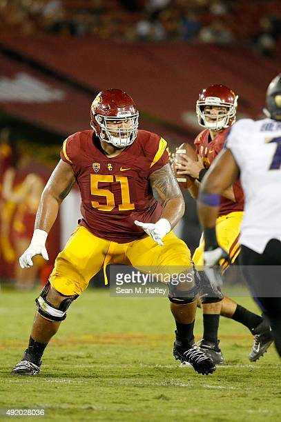 Damien Mama of the USC Trojans blocks during the third quarter of a game against the Washington Huskies at Los Angeles Memorial Coliseum on October 8...