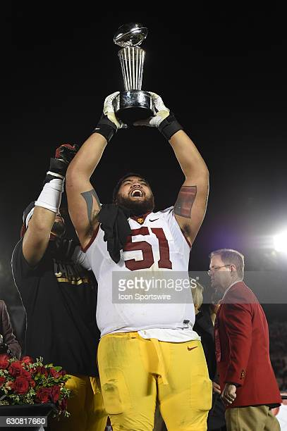 Damien Mama raises the Leishman Trophy at the conclusion of the Rose Bowl Game between the USC Trojans and the Penn State Nittanny Lions on January 2...
