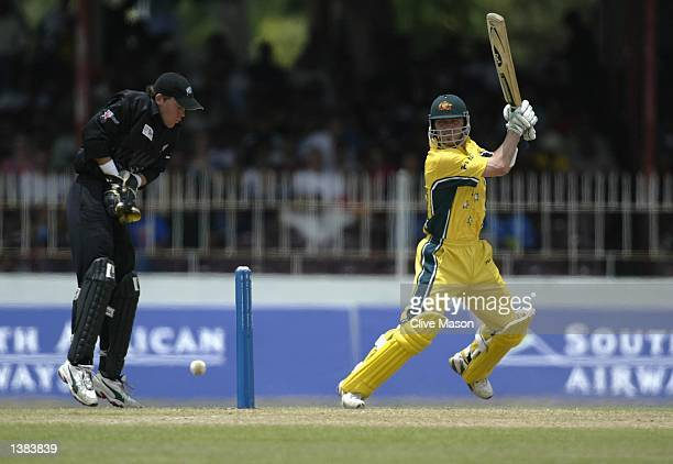 Damien Martyn of Australia in action on his way to a half century watched by Lou Vincent of New Zealand during the ICC Champions Trophy match between...