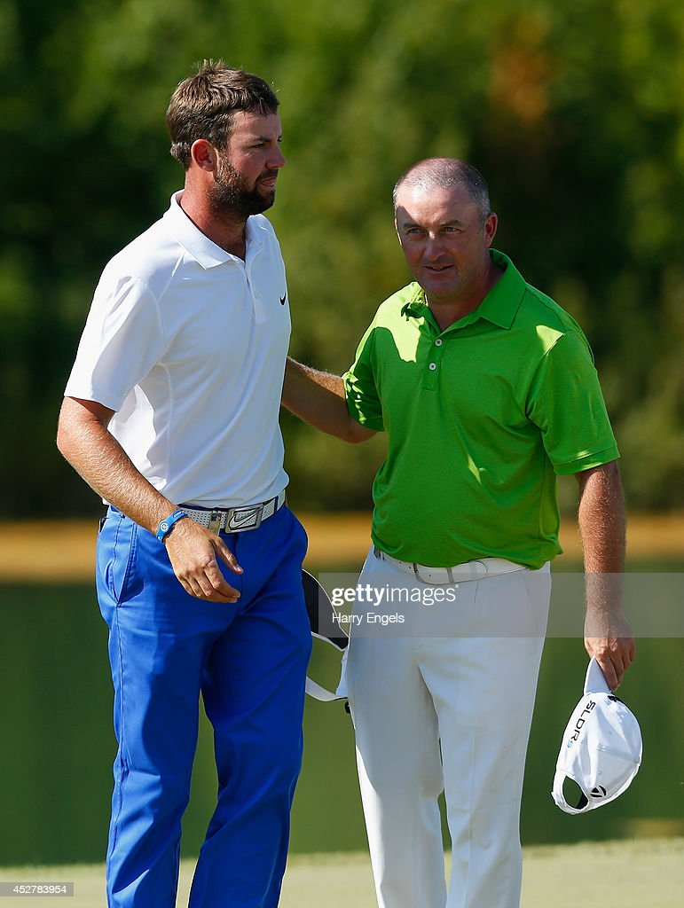 Damien McGrane of Ireland (R) and Scott Jamieson of Scotland (L) finish at the eighteenth on day four of the M2M Russian Open at Tseleevo Golf & Polo Club on July 27, 2014 in Moscow, Russia.
