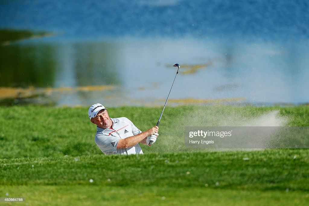 <a gi-track='captionPersonalityLinkClicked' href=/galleries/search?phrase=Damien+McGrane&family=editorial&specificpeople=228427 ng-click='$event.stopPropagation()'>Damien McGrane</a> of Ireland hits out of a bunker at the fifteenth on day two of the M2M Russian Open at Tseleevo Golf & Polo Club on July 25, 2014 in Moscow, Russia.