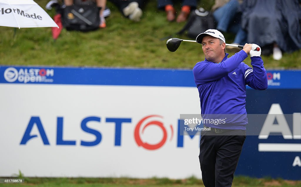 Damien McGrane of Ireland plays his first shot on the 1st tee during the Alstom Open de France - Day Four at Le Golf National on July 6, 2014 in Paris, France.