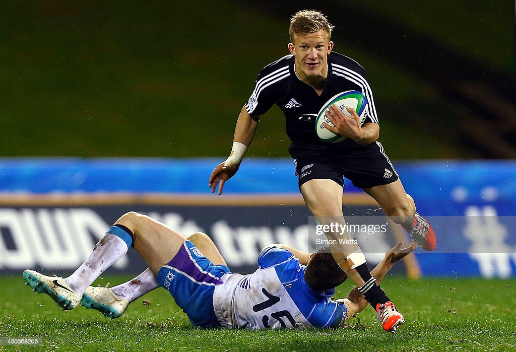 Damien McKenzie of New Zealand makes a break during the 2014 Junior World Championship match between New Zealand and Scotland at ECOLight Stadium, Pukekohe on June 10, 2014 in Auckland, New Zealand.