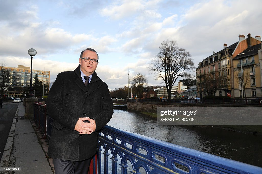 Damien Meslot, UMP right-wing party candidate for the 2014 municipal elections in Belfort, eastern France, poses on December 6, 2013. AFP PHOTO / SEBASTIEN BOZON