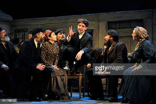 Damien Molony as Moti and Antony Sher as Jacob Bindel with artists of the company in Nicholas Wright's Travelling Light directed by Nicholas Wright...