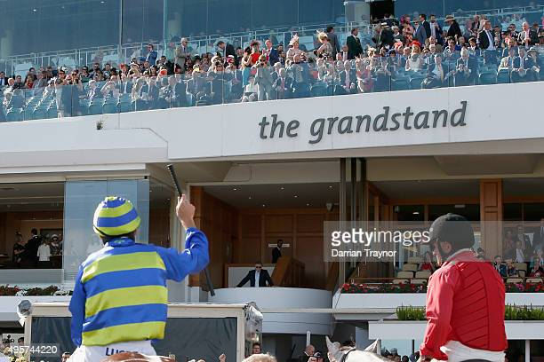 Damien Oliver acknowledges the crowd after riding Jameka to win race 8 the Crown Oaks on Oaks Day at Flemington Racecourse on November 5 2015 in...