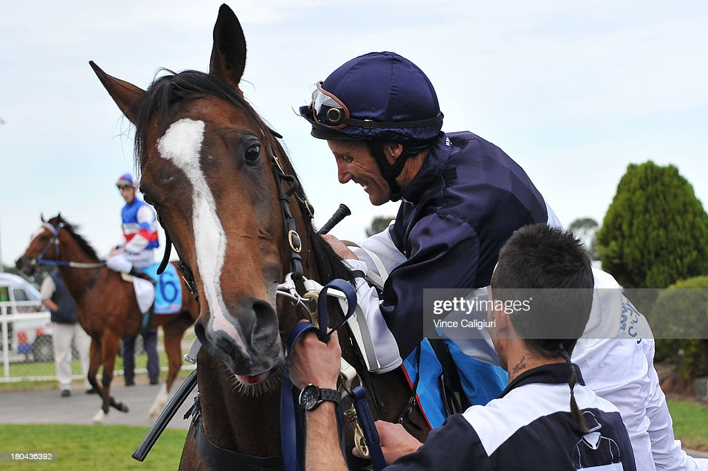<a gi-track='captionPersonalityLinkClicked' href=/galleries/search?phrase=Damien+Oliver&family=editorial&specificpeople=210504 ng-click='$event.stopPropagation()'>Damien Oliver</a> dismounts from Lion of Belfort after winning the Geelong & Surf Coast Limo Bus Maiden Plate during Geelong racing on September 13, 2013 in Geelong, Australia. <a gi-track='captionPersonalityLinkClicked' href=/galleries/search?phrase=Damien+Oliver&family=editorial&specificpeople=210504 ng-click='$event.stopPropagation()'>Damien Oliver</a> returned to race riding today after serving a 10-month ban for betting on a rival horse and rode a winner with his first ride back.